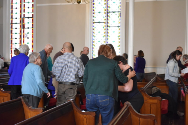 Church members greet each other during the service at the United Ministry of Delhi