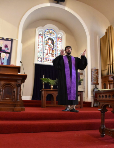 Pastor Bobby Outterson-Murphy preaches on Palm Sunday at the United Ministry of Delhi